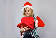 Young pretty woman with Christmas box Stock Images