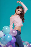 Young pretty woman with colored balloons Royalty Free Stock Image