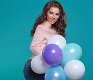 Young pretty woman with colored balloons Royalty Free Stock Photo