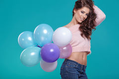 Young pretty woman with colored balloons Royalty Free Stock Images