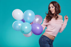 Young pretty woman with colored balloons Stock Image
