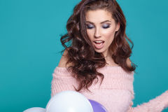 Young pretty woman with colored balloons Royalty Free Stock Photos