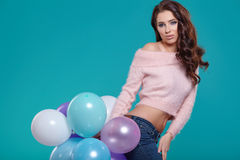 Young pretty woman with colored balloons Stock Photos