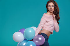Young pretty woman with colored balloons Royalty Free Stock Photography