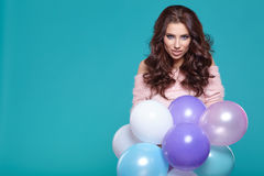 Young pretty woman with colored balloons Stock Images