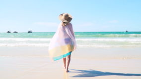 Young pretty woman with colorful cloth at Bang Tao Beach in Phuket, Thailand stock video footage