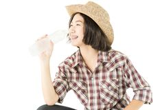 Woman in a plaid shirt holding a water bottle on white background royalty free stock photo