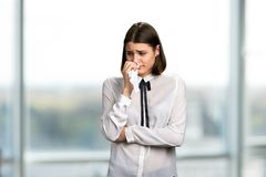 Young pretty woman is crying. royalty free stock images