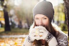 Young pretty woman with cup of tea Royalty Free Stock Photos