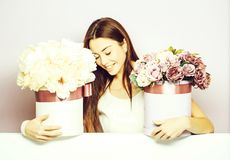 Pretty girl with flower boxes stock photos