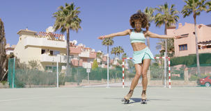 Young pretty woman dancing in roller skates Royalty Free Stock Photos