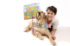 Young pretty woman, dog and Easter Stock Photography