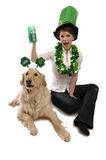Young pretty woman, dog and St. Patrick's Stock Photo