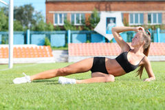 Young pretty woman doing exercises Stock Images
