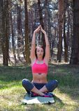 Young pretty woman doing yoga exercise Stock Photos