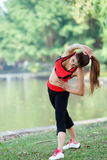 Young pretty woman doing yoga exercises in park Royalty Free Stock Photography