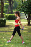 Young pretty woman doing yoga exercises in park Royalty Free Stock Image
