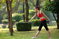 Young pretty woman doing yoga exercises in park Royalty Free Stock Photo