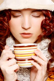 Young pretty woman drinking coffee Stock Photo