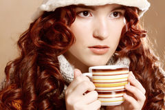 Young pretty woman drinking coffee Royalty Free Stock Photos