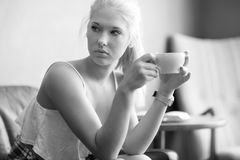 Young and pretty woman drinking coffee at cafe Stock Photo