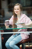 Young pretty woman drinking coffee in cafe Stock Image