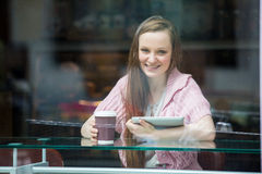 Young pretty woman drinking coffee in cafe Royalty Free Stock Photo