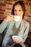 Young pretty woman drinking coffee Royalty Free Stock Photography