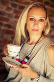 Young pretty woman drinking coffee Stock Image