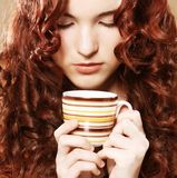 Young pretty woman drinking coffee Royalty Free Stock Photo