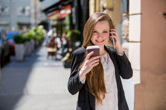 Young pretty woman drinking coffee on the street Stock Photos