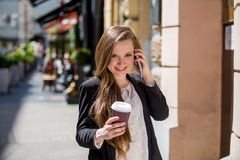 Young pretty woman drinking coffee on the street Royalty Free Stock Photo