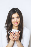 Young pretty woman drinking coffee or tea . Relaxing girl . Woman drinking coffee in the morning at home lifestyle. Royalty Free Stock Photo