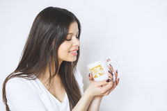 Young pretty woman drinking coffee or tea . Relaxing girl . Woman drinking coffee in the morning at home lifestyle. Stock Photography