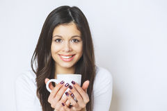 Young pretty woman drinking coffee or tea . Relaxing girl . Woman drinking coffee in the morning at home lifestyle. Stock Photo