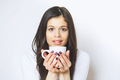Young pretty woman drinking coffee or tea . Relaxing girl . Woman drinking coffee in the morning at home lifestyle. Royalty Free Stock Photos