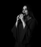 Young pretty woman drinks water Grayscale royalty free stock images
