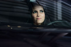 Young pretty woman driving car Stock Photos