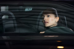 Young pretty woman driving car Royalty Free Stock Photos