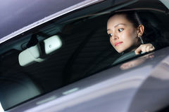 Young pretty woman driving car Royalty Free Stock Image