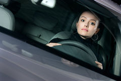Young pretty woman driving car Stock Images