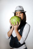 Young pretty woman eating green cabbage Stock Images