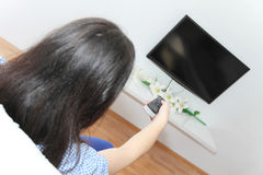 Young pretty woman enjoy watching tv Royalty Free Stock Image