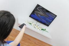 Young pretty woman enjoy watching tv Stock Photo