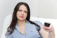 Young pretty woman enjoy watching tv Stock Photos