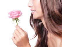 Young pretty woman enjoying smell pink rose Stock Photography