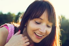 Young pretty woman enjoying sunny summer day Stock Images