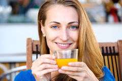 Young pretty woman enjoys cup of tea Royalty Free Stock Photo