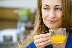 Young pretty woman enjoys cup of tea Stock Photography