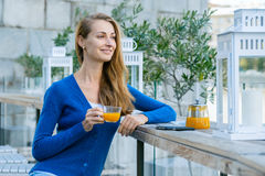 Young pretty woman enjoys cup of tea Stock Image